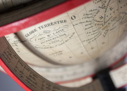 close up of globe label with red horizon ring