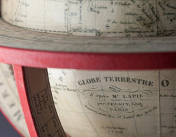 detail of globe cartouche from globe makers Lander and May