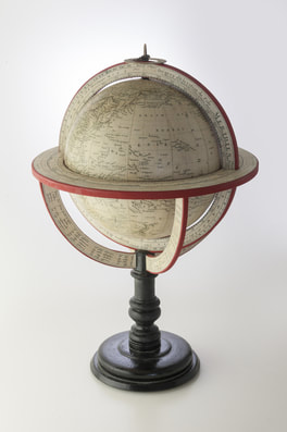 cut out of small globe from Lander and May globe makers